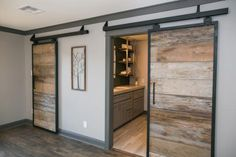 The sliding barn doors in the master bedroom of the newly renovated Ridley home, as seen on Fixer Upper. (After #1)
