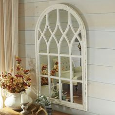 Add architectural interest to even the plainest wall with our Window Mirror. Place it anywhere you need a prettier view or in a corner that could benefit from beautifully reflected plays of light. A painted light brown finish completes the look. Window Mirror Decor, Arched Window Mirror, Faux Window, Arch Mirror, Arched Windows, Bay Windows, Wall Mirrors, Cathedral Mirror, Cathedral Windows