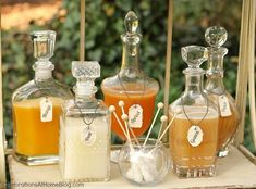 pretty decanters with mixing juices for champagne or sparkling wine