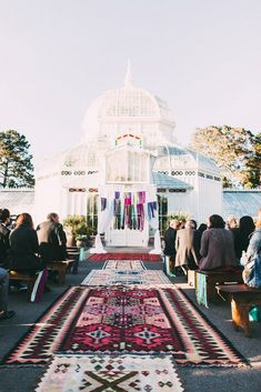 A Chic Modern Wedding at the Conservatory of Flowers - I love their use of these bohemian rugs for the aisle