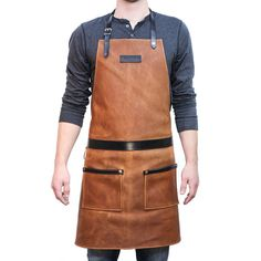 Hardmill's rugged leather apron handcrafted in the U. This leather apron is made with 4 oz. oil-tanned leather and 7 oz. An apron for men. Tool Apron, Men's Apron, Restaurant Uniforms, Grill Apron, Leather Apron, Leather Bags, Brown Leather, Waist Apron, Work Aprons