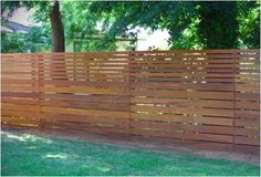 modern timber fence with smaller slats on top