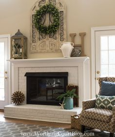 Red brick fireplace with brown trim painted white and brass fireplace screen painted with black high temp spray paint
