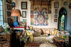 T Magazine: The Italian novelist Umberto Pasti in his study among old books, textiles and tiles in Tangier, Morocco. (Photo: Will Sanders)