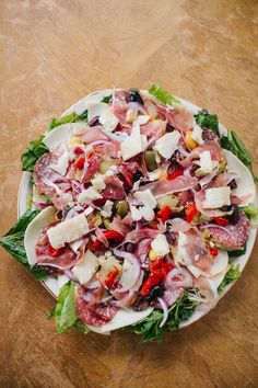 Mamma's Italian Style Antipasto | Lettuce, balsamic vinaigrette (use your favorite recipe), picked mushrooms, salami and prosciutto, roasted red peppers, onion (thinly sliced), capers, olives (sliced), artichoke hearts, lupini beans (optional, but they're the best ever), and parmesan cheese (chunks/slices).
