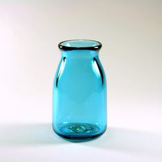 Glashjärta Glass, $45                                                                             An adorable small beaker shaped accent vase for any contemporary decor. This hand-crafted, blown glass vase was made in a hot shop on a pipe. It is a one of a kind piece. The base color is transparent turquoise.