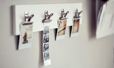 Super easy DIY project using a painted plank of wood, 4 bulldog clips and 4 screws...love!