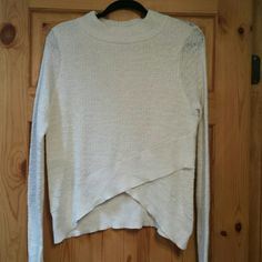 """Free people NWT wrap sweater --NWT, FP wrap design w plush texture, called ivory it rather cream for app purposes --mock cowl, not tight at neck..  ~~ size medium, runs bit large, see measurements --linen/cotton/polyester blend, hand wash cold, dry flat tho may SB dry cleaned ~~Only one of this color. Natural loose cabling on this sweater, a slight distressed look.  ~~ measurements flat: 17"""", shoulder to hem 25"""" @ longest on side & 24"""" in middle ~~MSRP: $88  Imported from EU  Offers welcome…"""