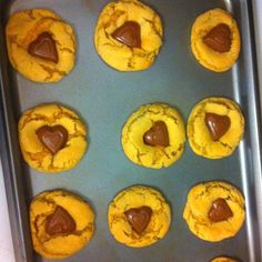 Peanut Butter Blossoms for Valentine's Day! Instead of placing hershey kisses on top of the peanut butter cookie, place heart chocolate shaped reeses on top!