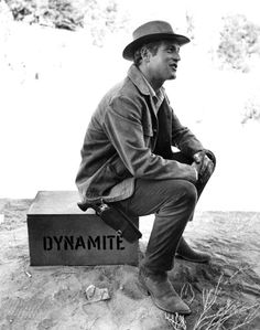 """""""Butch Cassidy & the Sundance Kid"""" (1968) - Paul Newman sits on a box of dynamite used in a train robbery - Directed by George Roy Hill - 20th Century-Fox."""