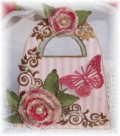 Kaisercraft wooden handbag kit, covered in My Minds Eye papers, and decorated a range of Cheery Lynn Designs dies.