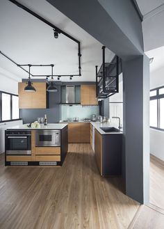 The design of this spacious and clean-cut four-room flat shows that not all industrial-style homes must have a grungy vibe.