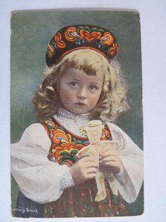 Solveig Lund Postcard Norway  Tradition of Bunad from different region.   She has a gingerbread. Must be Jul