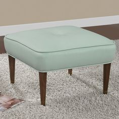 This bonded leather ottoman offers mid-century modern styling. The metal foot caps and big button tuft seal the deal on this retro ottoman. This ottoman features solid wood legs with metal caps and is upholstered in a retro aqua colored bonded leather. Mid Century, Decor, Home Living Room, Tufted Ottoman, Furniture, Ottoman, Apartment Living Room, Leather Ottoman, Home Decor