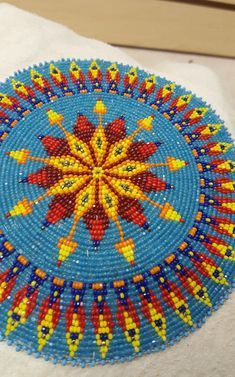 How To Make a Beaded Rosette Medallion - Craft Tutorials - Native American Pow Wows - - - This project will help you learn to do applique rosettes on a small project. Beaded medallion necklaces have been popular for both men and women dancers. Native Beading Patterns, Beadwork Designs, Bead Embroidery Patterns, Seed Bead Patterns, Native Beadwork, Native American Beadwork, Beaded Jewelry Patterns, Weaving Patterns, Beaded Embroidery