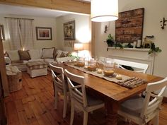 Wide pine floors, Pottery Barn Sumner table in Rustic Pine, Ikea Ektorp Sofa in white.  Neutral dining and family room.  www.thelongawaitedhome.com