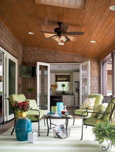 Soft cushions invite leisurely lounging on this porch, while patterned rugs provide comfort and texture underfoot. Midwest Living