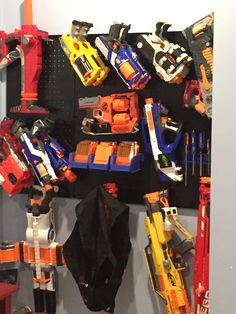 Store Nerf Guns and bullets using Wall Control Pegboard. Its easy for kids to use making clean up a whole lot easier. Thanks for the photo Kim! Metal Pegboard, Pegboard Storage, Nerf Gun Storage, Tool Organization, Bullets, Guns, Store, Wall, Weapons Guns