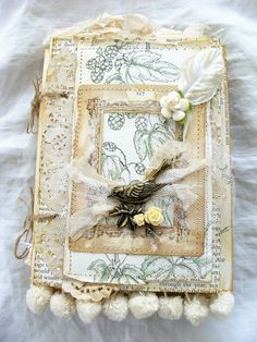 Unique vintage journal with a nature theme...  Front cover features a bird charm with a crystal dangle sitting in a vintage photo mat over a book page from a beautiful vintage garden book with a velvet leaf and millinery flower. Inside front cover has a double pocket. Inside back cover has a single side-loading pocket. Iv used vintage garden book pages and pretty cardstock to create pages, tuck spots, and pockets, some pockets made from tracing paper and pretty vellum. Includes fold out…