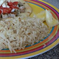 Lemon Basmati Rice  2 teaspoons canola oil   1 cup basmati rice, rinsed   1 (2 inch) piece fresh ginger, minced   1 lemon, juiced and zested   2 cups chicken broth   salt and ground black pepper to taste