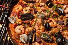 Make this classic paella recipe with meat and seafood quick and easy. Not only is it an impressive dish with lots of Spanish flair it is also very tasty!