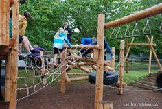 Children clambering across the scramble net