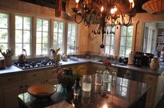 Zinc countertops are a classic modern material for kitchens and furniture. This cool metal is warmer than stainless steel and adds to a transitional decor. Zinc Countertops, Countertop Materials, Transitional Decor, Seafood Restaurant, Modern Materials, French Country, Table, Furniture, Design