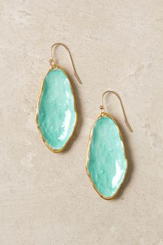 "gorgeous ""puddle earrings"" by Alexis Bittar. aqua enamel in a concave gold-fill basin. $195"
