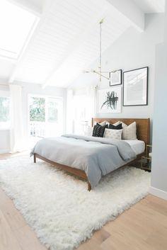 love the textures (brass, wood, patterns, rug..), chandler, light filled room