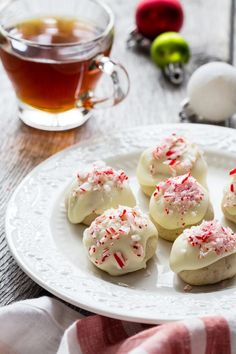 Candy Cane Snowball Cookies are a must-add to your holiday cookie tray. Buttery sweet shortbread, peppermint and vanilla candy melts make for holiday flavor perfection.