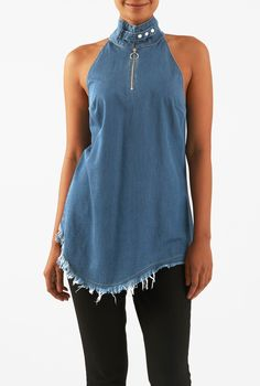 An asymmetrical hemline with frayed edges reinforces the medium blue wash of our cotton denim tunic top styled with a front metal zip from the button tabbed turtle neck.