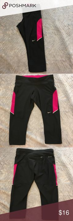 Nike Crops Nike black with pink Crops. One snag on front, pic 4. Otherwise great condition. Size small. Back zipper. ❌No Trades❌Proceeds go towards feeding the homeless❗️ Nike Pants Ankle & Cropped
