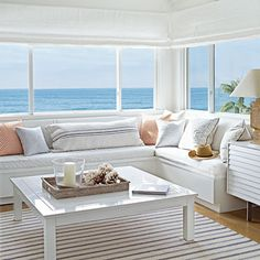 These mostly white furnishings allow the beautiful view to take center stage | Coastalliving.com