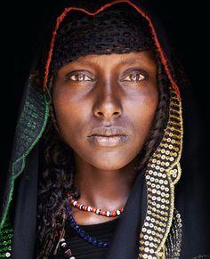 Oromo, Ethiopia     This Oromo girl in a mountain village in eastern Ethiopia wears a striking, vibrantly coloured headscarf. Older Oromo women also carried umbrellas to shield them from the sun.