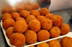 Faicco's in Greenwich Village is basically a butcher shop. But you can buy these arancini — crispy fried risotto ball — freshly made. They are so good.