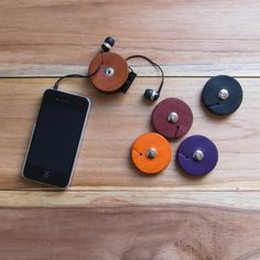 Leather organizers keep earbud cords tangle-free.