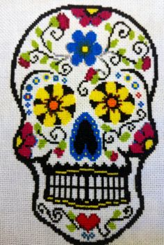 vibrantly colored sugar skull cross stitching on Etsy, $8.50
