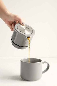 """Tea For One"" stainless-steel tea infuser complete with a built-in teapot + cup, designed by For Life Design. $39. (Sometimes Urban Outfitters comes up with a gem.)"