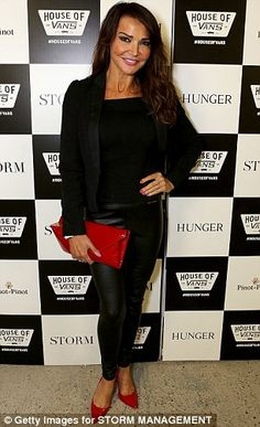 Lizzy Cundy wore black leather trousers and red accessories...