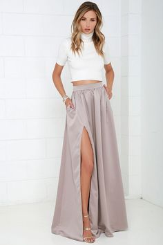 Poets and laureates alike will muse upon how lovely you look as you wander through the gardens in the 'Twas a Dream Taupe Maxi Skirt! Satiny woven fabric with a luxurious sheen falls from a high, fitted waist into a billowing maxi skirt with a sultry thigh high slit. Hidden zipper/hook closure at back.