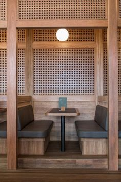 Inside Sydney's newly renovated Paddington Inn: Booth seating in the…