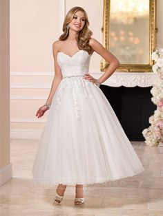 A blast from the past, this short wedding dress from Stella York features a fitted lace bodice, figure-flattering Diamante waist belt, and a whimsical tulle ankle-length skirt. A Line Wedding Dress Sweetheart, Lace Wedding Dress, Tea Length Wedding Dress, Tea Length Dresses, Ball Dresses, Popular Wedding Dresses, 2016 Wedding Dresses, Bridal Dresses, Wedding Gowns