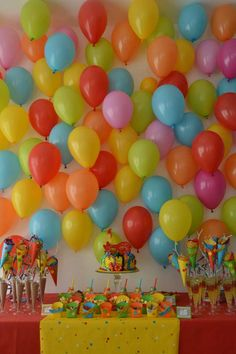 Rainbow carnivale birthday party balloon backdrop! See more party planning ideas at CatchMyParty.com!