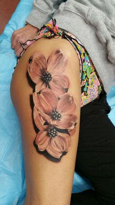 Dogwood flowers tattoo on a thigh. Black and grey floral  photo realism