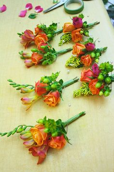 Freesia and spray rose boutonnieres by Lasater Flowers