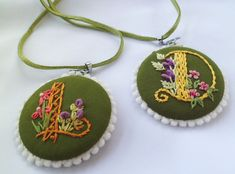 Embroidered Initial Necklace Pendant by SoffiLovely on Etsy, $15.00  Necklace pendant with embroidered initial. All handmade.  Diameter 1,6 inch (4,5 cm) with 35 inch (90 cm) suede cord.   These necklaces are made to order (pre-order). You choose what initial you would like.  Fabric : cotton