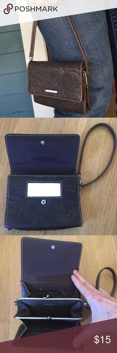 "9️⃣NINE WEST Pleather Wallet/Wristlet/Mini Handbag SO versatile!9️⃣NINE WEST Pleather Wallet/Wristlet/Mini Handbag.  Handy, well designed, versatile.   Mini purse with strap that can adjust to wristlet or wallet.  Front snap flap.  Includes mirror, coin purse, ID, credit card  & rear pockets.  6"" x 4-1/2"" x 1"".   6-1/2"" strap drop.  Excellent condition. Nine West Bags Clutches & Wristlets"