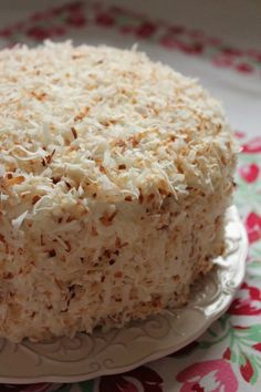 Coconut Cake: A cake flavored lightly with coconut milk, layered with a coconut filling, covered in buttercream made with a splash of coconut milk, and topped with toasted shredded coconut.