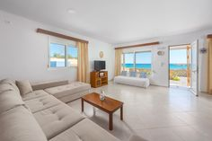 The Rhodes South Escape beach front Plimmiri - Holiday homes & villas on Rhodes Island Greece Rhodes Island Greece, 4 Bedroom House, Sofas, Beach House, Villa, Couch, Furniture, Home Decor, Couches