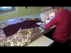Learn how to move a large quilt on your home sewing machine, working from the center to the outside.  See how the quilt moves and is manipulated so the weight and bulk of the quilt isn't overwhelming while quilting on a small machine.